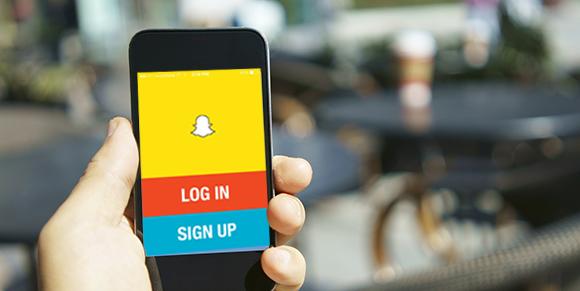 holding-snapchat-phone-login-screen
